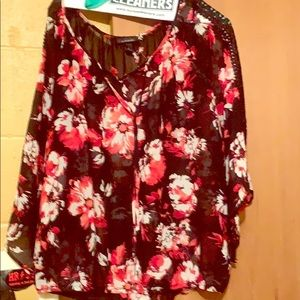Women's black red floral print blouse.